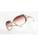 NWT Champagne UV protect lady's sunglasses - $29.00