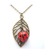 Antiqued Brass Leaf Porcelain Ladybug Necklace - $14.99