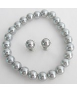 Classy Gray Pearls Stretchable Bracelet Stud Ea... - $15.98