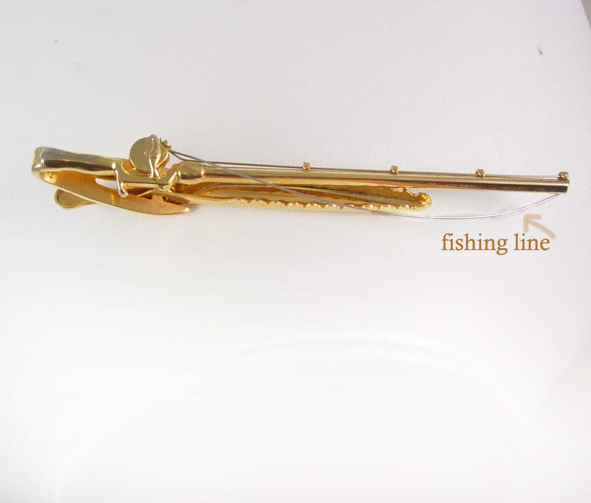 Hickok fly fishing tie clip pole reel with line sportsmen for Tying fishing line to reel