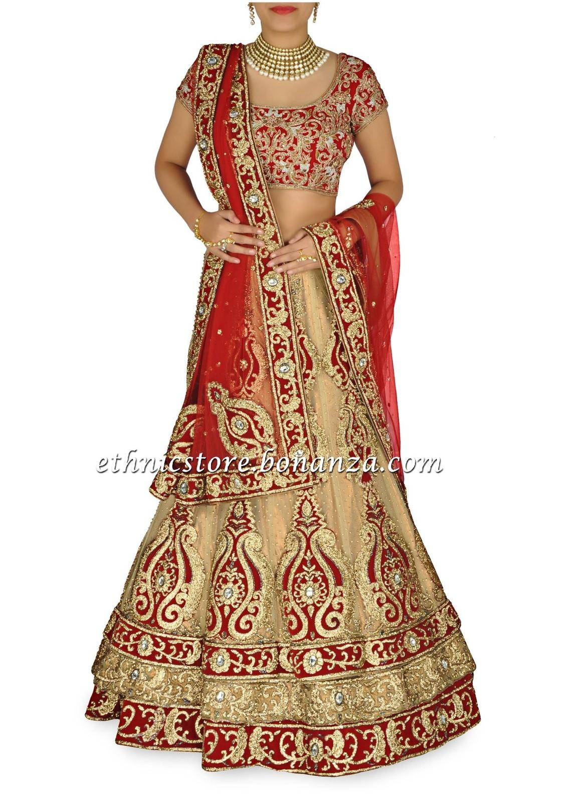 Pretty humble gold & red combination bridal lehenga - Choli