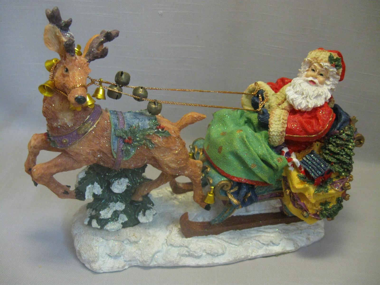 Santa S Bag Of Toys : Statue figurine santa on his sleigh glitter design
