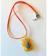wire wrapped angel charm on bright yellow penda... - $9.89