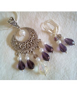 Stunning Open Scroll Pendant With Purple Swarov... - $26.99