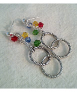 Circle Of Life Drop Charm Earrings With Swarvos... - $15.99