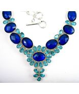 Faceted Sapphire Blue Topaz with Aqua Blue Topa... - $419.52