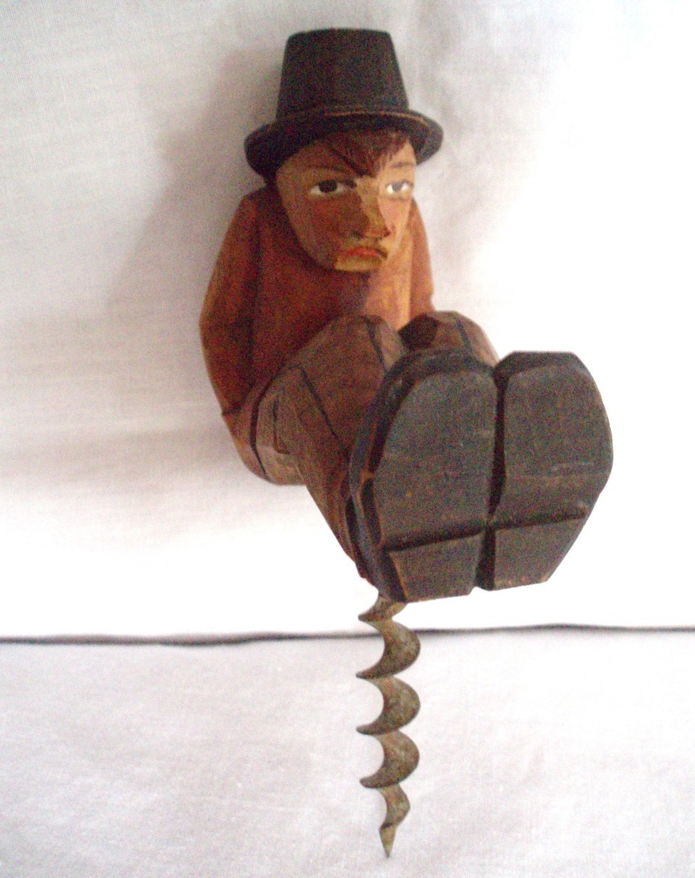 carved man wood corkscrew barware Anri bottle opener