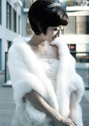 Warm faux fur shrug for wedding - white