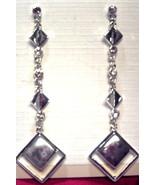 Silver toned dangle earrings - $2.00