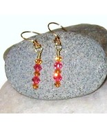 Swarovski crystal pink and topaz earrings - $12.00