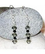 Swarovski crystal black diamond and jet black E... - $12.00