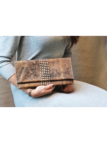 tan leather clutch with stud embellishment