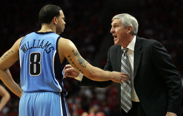 HOUSTON - MAY 5:  Head coach Jerry Sloan talks with Deron Williams #8 of the Utah Jazz in Game Seven of the Western Conference Quarterfinals during the 2007 NBA Playoffs at Toyota Center May 5, 2007 in Houston, Texas. NOTE TO USER: User expressly acknowledges and agrees that, by downloading and/or using this Photograph, user is consenting to the terms and conditions of the Getty Images License Agreement.  (Photo by Ronald Martinez/Getty Images)