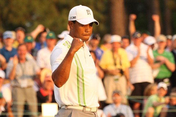 AUGUSTA, GA - APRIL 08:  Tiger Woods celebrates his birdie putt on the 18th green during the second round of the 2011 Masters Tournament at Augusta National Golf Club on April 8, 2011 in Augusta, Georgia.  (Photo by Andrew Redington/Getty Images)