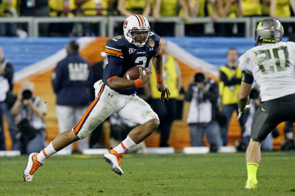 GLENDALE, AZ - JANUARY 10:  Cameron Newton #2 of the Auburn Tigers runs down field against John Boyett #20 of the Oregon Ducks during the Tostitos BCS National Championship Game at University of Phoenix Stadium on January 10, 2011 in Glendale, Arizona.  (Photo by Kevin C. Cox/Getty Images)