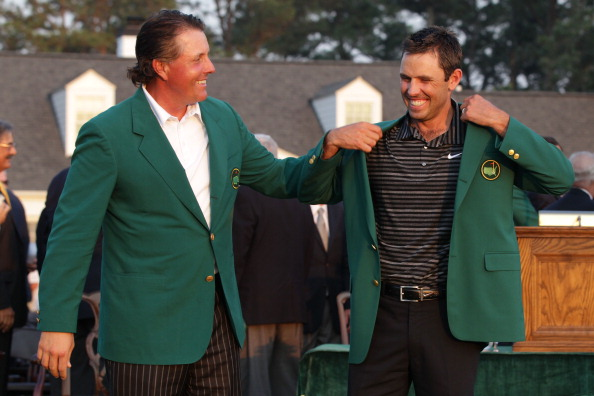 AUGUSTA, GA - APRIL 10:  Phil Mickelson presents Charl Schwartzel of South Africa the winner's jacket at the green jacket presentation after Schwartzel's two-stroke victory at the 2011 Masters Tournament at Augusta National Golf Club on April 10, 2011 in Augusta, Georgia.  (Photo by David Cannon/Getty Images)