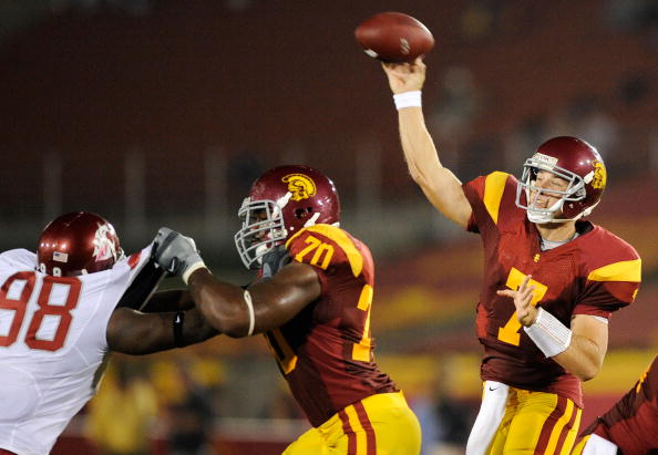 LOS ANGELES, CA - SEPTEMBER 26:   Quarterback Matt Barkley #7 of the USC Trojans throws a pass as Tyron Smith #70 blocks Jesse Feagin #98 of  the Washington State Cougars during the second quarter of the college football game at the Los Angeles Memorial Coliseum on September 26, 2009 in Los Angeles, California.  (Photo by Kevork Djansezian/Getty Images)