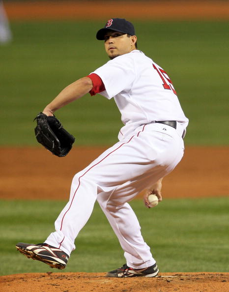 BOSTON - APRIL 04: Josh Beckett #19 of the Boston Red Sox pitches in the second inning against the New York Yankees on Opening Night at Fenway Park on April 4, 2010 in Boston, Massachusetts. (Photo by Jim Rogash/Getty Images)