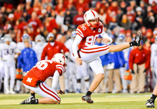 LINCOLN, NE - NOVEMBER 13: Alex Henery #90 of the Nebraska Cornhuskers kicks an extra point against the Kansas Jayhawks during their game at Memorial Stadium on November 13, 2010 in Lincoln, Nebraska. Nebraska Defeated Kansas 20-3. (Photo by Eric Francis/Getty Images)