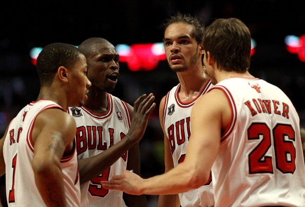 CHICAGO, IL - MARCH 25: (L-R) Derrick Rose #1, Loul Deng #9, Joakim Noah #13 and Kyle Korver #26 of the Chicago Bulls gather to talk during a game against the Memphis Grizzlies at the United Center on March 25, 2011 in Chicago, Illinois. The Bulls defeated the Grizzlies 99-96. NOTE TO USER: User expressly acknowledges and agrees that, by downloading and/or using this photograph, User is consenting to the terms and conditions of the Getty Images License Agreement. (Photo by Jonathan Daniel/Getty Images)