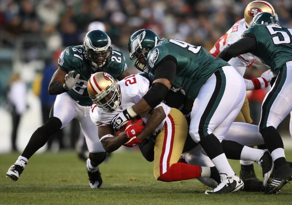 PHILADELPHIA - DECEMBER 20:  Frank Gore #21 of the San Francisco 49ers is tackled by Brodrick Bunkley #97 of the Philadelphia Eagles at Lincoln Financial Field on December 20, 2009 in Philadelphia, Pennsylvania.  (Photo by Nick Laham/Getty Images)