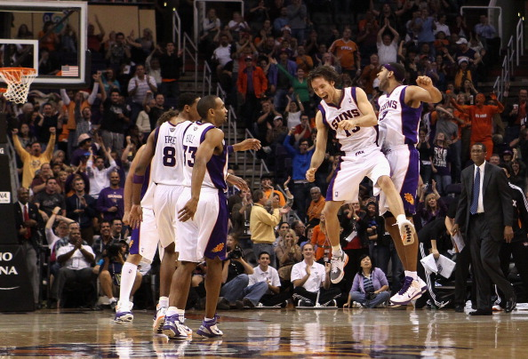 PHOENIX - DECEMBER 15:  Steve Nash #13 and Jared Dudley #3 of the Phoenix Suns celebrate after hitting a three point shot against the Minnesota Timberwolves during the NBA game at US Airways Center on December 15, 2010 in Phoenix, Arizona. The Suns defeated the Timberwolves 128-122. NOTE TO USER: User expressly acknowledges and agrees that, by downloading and or using this photograph, User is consenting to the terms and conditions of the Getty Images License Agreement.  (Photo by Christian Petersen/Getty Images)