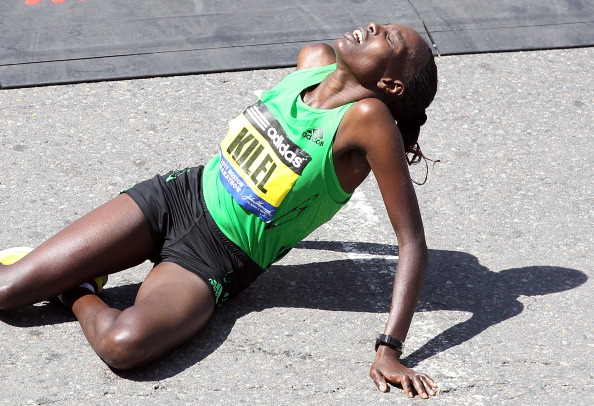 BOSTON, MA - APRIL 18: Caroline Kilel #8 of Kenya reacts after winning the women's division of the 115th running of the Boston Marathon on April 18, 2011 in Boston, Massachusetts. (Photo by Jim Rogash/Getty Images)
