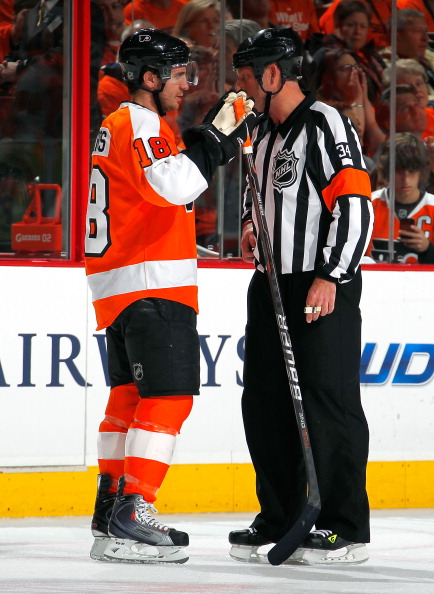 PHILADELPHIA, PA - APRIL 16:  Mike Richards #18 of the Philadelphia Flyers talks with referee Brad Meier #34 in Game Two of the Eastern Conference Quarterfinals against the Buffalo Sabres during the 2011 NHL Stanley Cup Playoffs at Wells Fargo Center on April 16, 2011 in Philadelphia, Pennsylvania.  (Photo by Paul Bereswill/Getty Images)