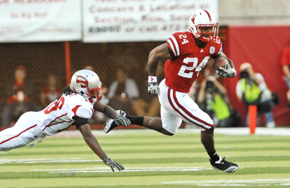LINCOLN, NE - SEPTEMBER 04:  Jamal Forest #18 of the Western Kentucky Hilltoppers  tries to bring down Niles Paul #24 of the Nebraska Cornhuskers during first half action of their game at Memorial Stadium on September 4, 2010 in Lincoln, Nebraska.  Nebraska defeated Western Kentucky 49-10. (Photo by Eric Francis/Getty Images)