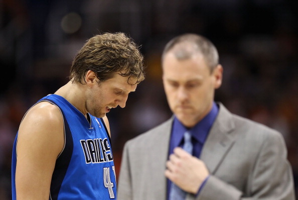 PHOENIX, AZ - MARCH 27:  Dirk Nowitzki #41 of the Dallas Mavericks walks by head coach Rick Carlisle during the NBA game against the Phoenix Suns at US Airways Center on March 27, 2011 in Phoenix, Arizona.  The Mavericks defeated the Suns 91-83.  NOTE TO USER: User expressly acknowledges and agrees that, by downloading and or using this photograph, User is consenting to the terms and conditions of the Getty Images License Agreement.  (Photo by Christian Petersen/Getty Images)