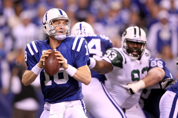 INDIANAPOLIS, IN - JANUARY 08:  Quarterback Peyton Manning #18 of the Indianapolis Colts looks to pass against the New York Jets during their 2011 AFC wild card playoff game at Lucas Oil Stadium on January 8, 2011 in Indianapolis, Indiana. The Jets won 17-16.  (Photo by Andy Lyons/Getty Images)