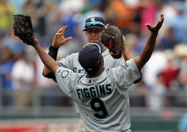 KANSAS CITY, MO - APRIL 17:   #17 and Chone Figgins #9 of the Seattle Mariners celebrate after the Mariners defeated the Kansas City Royals 3-2 to win the game on April 17, 2011 at Kauffman Stadium in Kansas City, Missouri.  (Photo by Jamie Squire/Getty Images)