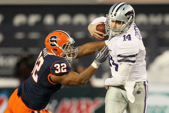 NEW YORK, NY - DECEMBER 30:  Carson Coffman #14 of the Kansas State Wildcats gets out of the tackle of Doug Hogue #32 of the Syracuse Orange during the New Era Pinstripe Bowl at Yankee Stadium on December 30, 2010 in New York, New York.  (Photo by Chris McGrath/Getty Images)