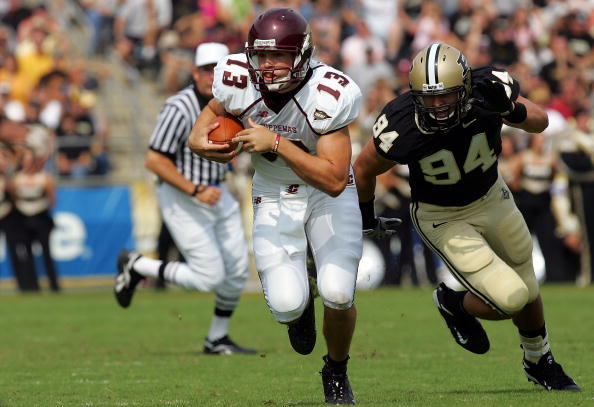 WEST LAFAYETTE, IN - SEPTEMBER 20:  Quarterback Dan LeFevour #13 of the Central Michigan Chippewas runs the ball past Ryan Kerrigan #94 of the Purdue Boilermakers at Ross-Ade Stadium on September 20, 2008 in West Lafayette, Indiana.  (Photo by Ronald Martinez/Getty Images)