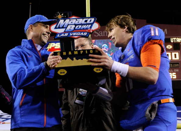 LAS VEGAS, NV - DECEMBER 22:  Head coach Chris Petersen (L) and quarterback Kellen Moore #11 of the Boise State Broncos hold up a trophy as they celebrate their 26-3 victory over the Utah Utes in the MAACO Bowl Las Vegas at Sam Boyd Stadium December 22, 2010 in Las Vegas, Nevada.  (Photo by Ethan Miller/Getty Images)