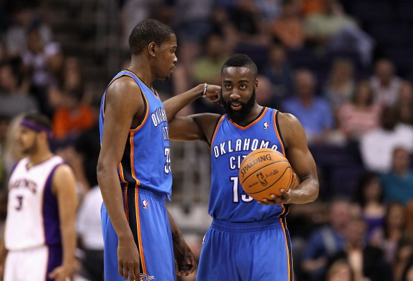 PHOENIX, AZ - MARCH 30:  Kevin Durant #35 and James Harden #13 of the Oklahoma City Thunder talk during the NBA game against the Phoenix Suns at US Airways Center on March 30, 2011 in Phoenix, Arizona. The Thunder defeated the Suns 116-98.   NOTE TO USER: User expressly acknowledges and agrees that, by downloading and or using this photograph, User is consenting to the terms and conditions of the Getty Images License Agreement.  (Photo by Christian Petersen/Getty Images)