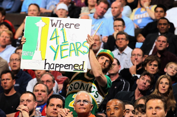 DENVER, CO - APRIL 23:  Seattle Sonics fans display signs as the support the Denver Nuggets against the Oklahoma City Thunder in Game Three of the Western Conference Quarterfinals in the 2011 NBA Playoffs on April 23, 2011 at the Pepsi Center in Denver, Colorado. NOTE TO USER: User expressly acknowledges and agrees that, by downloading and or using this photograph, User is consenting to the terms and conditions of the Getty Images License Agreement.  (Photo by Doug Pensinger/Getty Images)