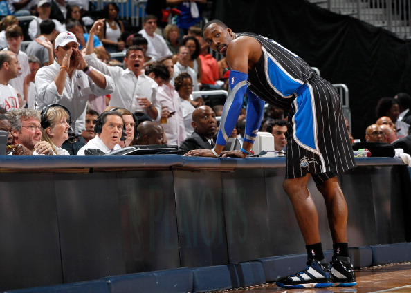 ATLANTA, GA - APRIL 28:  Dwight Howard #12 of the Orlando Magic stands at the scorer's table after being earning a technical foul against Zaza Pachulia #27 of the Atlanta Hawks during Game Six of the Eastern Conference Quarterfinals in the 2011 NBA Playoffs at Philips Arena on April 28, 2011 in Atlanta, Georgia.  NOTE TO USER: User expressly acknowledges and agrees that, by downloading and or using this photograph, User is consenting to the terms and conditions of the Getty Images License Agreement.  (Photo by Kevin C. Cox/Getty Images)