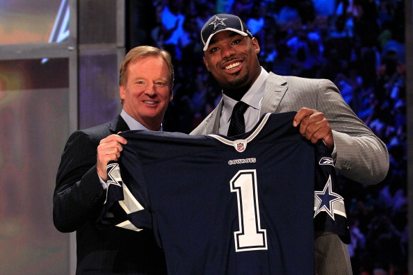 NEW YORK, NY - APRIL 28:  NFL Commissioner Roger Goodell (L) poses for a photo with Tyron Smith, #9 overall pick by the Dallas Cowboys, on stage during the 2011 NFL Draft at Radio City Music Hall on April 28, 2011 in New York City.  (Photo by Chris Trotman/Getty Images)