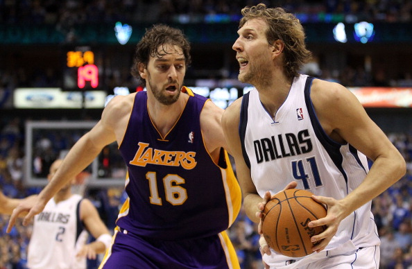 DALLAS, TX - MAY 08:  Forward Dirk Nowitzki #41 of the Dallas Mavericks dribbles the ball against Pau Gasol #16 of the Los Angeles Lakers in Game Four of the Western Conference Semifinals during the 2011 NBA Playoffs on May 8, 2011 at American Airlines Center in Dallas, Texas.  NOTE TO USER: User expressly acknowledges and agrees that, by downloading and or using this photograph, User is consenting to the terms and conditions of the Getty Images License Agreement.  (Photo by Ronald Martinez/Getty Images)