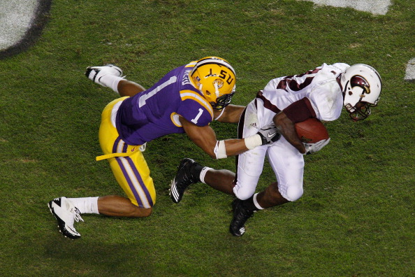 BATON ROUGE, LA - NOVEMBER 13:  Luther Ambrose #22 of the University of Louisiana-Monroe Warhawks is tackled by Eric Reid #1 of the Louisiana State University Tigers at Tiger Stadium on November 13, 2010 in Baton Rouge, Louisiana.  The Tigers defeated the Warhawks 51-0.  (Photo by Chris Graythen/Getty Images)