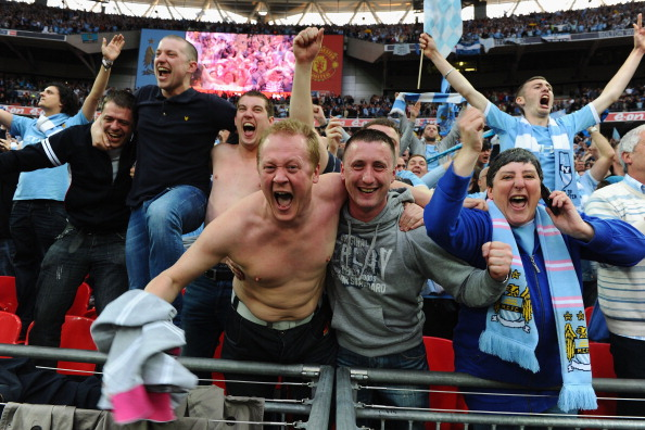 LONDON, ENGLAND - APRIL 16:  Man City fans celebrate victory at the FA Cup sponsored by E.ON semi final match between Manchester City and Manchester United at Wembley Stadium on April 16, 2011 in London, England.  (Photo by Mike Hewitt/Getty Images)