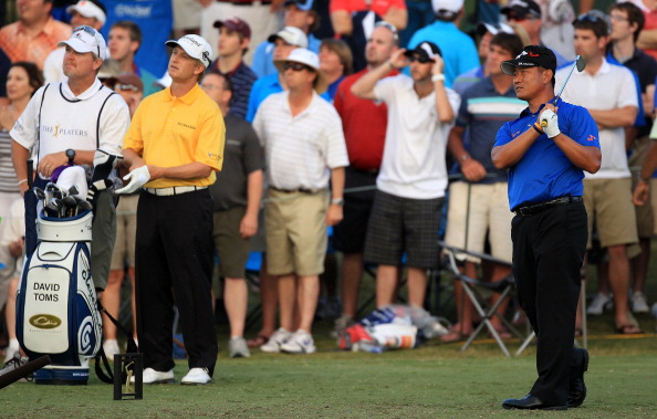 PONTE VEDRA BEACH, FL - MAY 15:  K.J. Choi of South Korea hits his tee shot on the first playoff hole as David Toms looks on during the final round of THE PLAYERS Championship held at THE PLAYERS Stadium course at TPC Sawgrass on May 15, 2011 in Ponte Vedra Beach, Florida.  (Photo by Streeter Lecka/Getty Images)