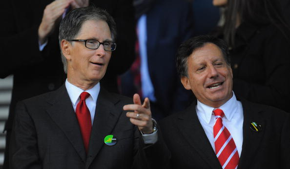LIVERPOOL, ENGLAND - OCTOBER 17: New Liverpool co-owners John W Henry (L) and NESV Chairman Tom Werner look on during the Barclays Premier League match between Everton and Liverpool at Goodison Park on October 17, 2010 in Liverpool, England.  (Photo by Michael Regan/Getty Images)