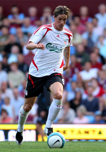 BIRMINGHAM, UNITED KINGDOM - AUGUST 11:  Liverpool striker Fernando Torres runs with the ball during the Barclays Premier League Match between Aston Villa and Liverpool at Villa Park on August 11, 2007 in Birmingham, England.  (Photo by Stu Forster/Getty Images)