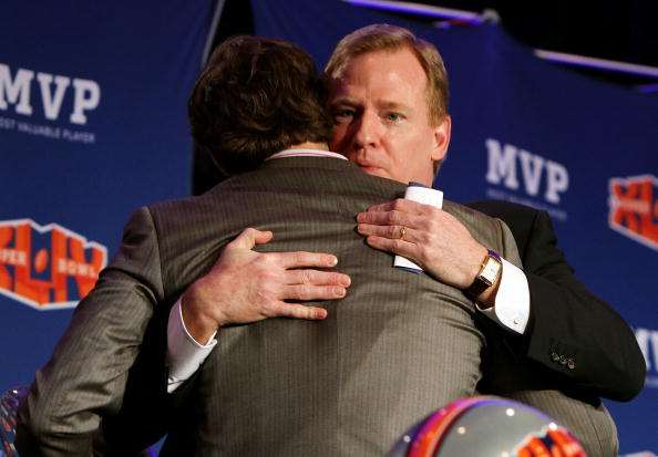 FORT LAUDERDALE, FL - FEBRUARY 08:  Super Bowl XLIV Most Valuable Player, quarterback Drew Brees #9 of the New Orleans Saints hugs NFL Commissioner Roger Goodell before speaking during the Super Bowl Champion Coach Press Conference at the Fort Lauderdale Convention Center on February 8, 2010 in Fort Lauderdale, Florida.  (Photo by Doug Benc/Getty Images)