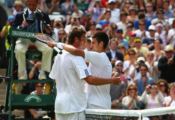 LONDON - JUNE 25:  Marat Safin of Russia hugs Novak Djokovic of Serbia after winning the men's singles round two match on day three of the Wimbledon Lawn Tennis Championships at the All England Lawn Tennis and Croquet Club on June 25, 2008 in London, England.  (Photo by Ryan Pierse/Getty Images)