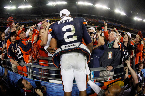GLENDALE, AZ - JANUARY 10:  Quarterback Cameron Newton #2 of the Auburn Tigers celebrates the Tigers 22-19 victory with the fans after defeating the Oregon Ducks in the Tostitos BCS National Championship Game at University of Phoenix Stadium on January 10, 2011 in Glendale, Arizona.  (Photo by Jonathan Ferrey/Getty Images)