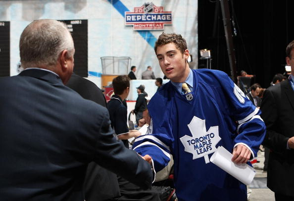 MONTREAL , QC - JUNE 27:  Jesse Blacker greets team representatives after being drafted by the Toronto Maple Leafs during the second day of the 2009 NHL Entry Draft at the Bell Centre on June 27, 2009 in Montreal, Quebec, Canada. (Photo by Bruce Bennett/Getty Images)