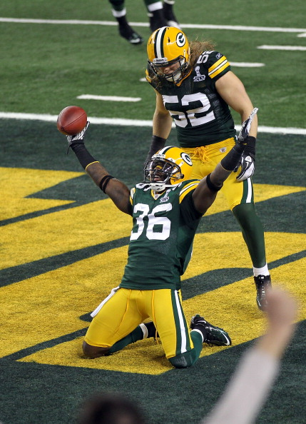 ARLINGTON, TX - FEBRUARY 06:  Nick Collins #36 of the Green Bay Packers celebrates with teammate Clay Matthews #52 after Collins returned an interception for a touchdown against the Pittsburgh Steelers during Super Bowl XLV at Cowboys Stadium on February 6, 2011 in Arlington, Texas. The Packers won 31-25.  (Photo by Mike Ehrmann/Getty Images)